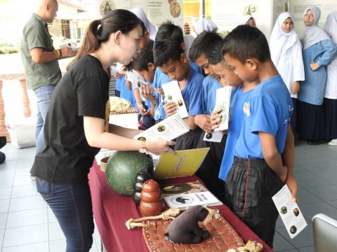Students visiting BSBCC's educational booth