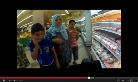 Malay family looking a bicycle in supermarket