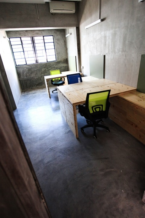 The private suite offers 3 recycled pallet tables and cupboards coupled with an individual chalkboard.
