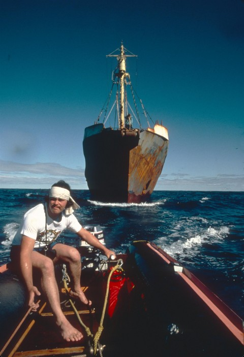 Greenpeace activist Paul Watson on  zodiac in front of whaling vessel.